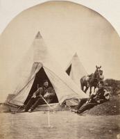 0622255 © Granger - Historical Picture ArchiveCRIMEAN WAR: OFFICER, 1855.   Officer of the British 57th Regiment sitting outside of his tent with another officer, as a servant waits with a horse. Photograph by Roger Fenton, 1855.