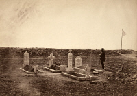 0622362 © Granger - Historical Picture ArchiveCRIMEAN WAR, CATHCART'S HILL.   A man stands next to the grave of Brigadier General Thomas Leigh Goldie in a cemetery on Cathcart's Hill, killed at the Battle of Inkerman during the Crimean War. Photograph by Roger Fenton, 1855.