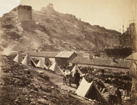 0622363 © Granger - Historical Picture ArchiveCRIMEAN WAR: BALAKLAVA.   Ruins of a Genoese castle overlooking an encampment and Balaklava harbor during the Crimean War. Photograph by Roger Fenton, 1855.