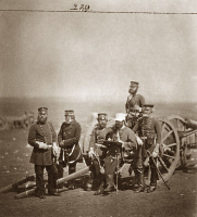 0622365 © Granger - Historical Picture ArchiveCRIMEAN WAR: ARTILLERY.   A group of officers around an artillery gun and carriage during the Crimean War. Photograph by Roger Fenton, 1855.