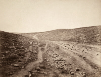 0622366 © Granger - Historical Picture ArchiveCRIMEAN WAR: VALLEY OF DEATH.   'The Valley of the Shadow of Death.' A dirt road scattered with cannonballs following the Battle of Balaklava; the image was contemporarily associated with the Charge of the Light Brigade, which occurred nearby during that battle. Photograph by Roger Fenton, 1855.