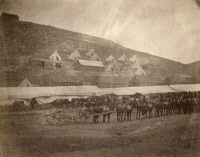 0622368 © Granger - Historical Picture ArchiveCRIMEAN WAR: HORSE ARTILLERY.   A team of horses with wheeled artillery guns, with tents and barracks in the background, during the Crimean War. Photograph by Roger Fenton, 1855.