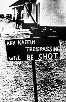 0115805 © Granger - Historical Picture ArchiveSOUTH AFRICA: APARTHEID.   A sign threatening blacks with violence posted in a white neighborhood in South Africa, following the government's implementation of apartheid policies in 1948.