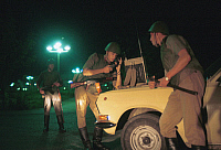 0352498 © Granger - Historical Picture ArchiveDISSOLUTION OF USSR, 1989.   Military troops guard people in Fergana Valley at night in Uzbekistan, 1989. Full credit: ITAR-TASS Photo Agency / Granger, NYC -- All rights reserved.