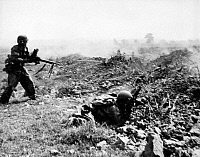 0095547 © Granger - Historical Picture ArchiveDIEN BIEN PHU, 1954.   French union soldiers advance on Viet Minh forces at Dien Bien Phu during the French Indochina War. Photographed April 1954.