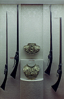 0053317 © Granger - Historical Picture ArchiveBREASTPLATE, 17th CENTURY.   Breastplate of Louis XIII and flint-lock muskets and rifles from the Royal armory of Louis XIV.