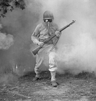 0409529 © Granger - Historical Picture ArchiveGAS MASK, 1942.   Sergeant George Camblair learning how to use a gas mask in a practice smokescreen at Fort Belvoir, Virginia. Photograph by Jack Delano, September 1942.