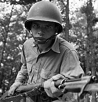 0122712 © Granger - Historical Picture ArchiveWORLD WAR II: SERGEANT, 1942.   Sergeant George Camblair learning to use a bayonet while training at Fort Belvoir, Virginia. Photograph by Jack Delano, September 1942.
