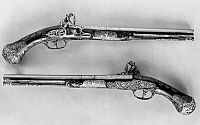 0216804 © Granger - Historical Picture ArchiveFLINTLOCK PISTOLS, 1690.   A pair of matching flintlock pistols bearing the inscriptions 'Viena liberata' and 'Buda superata' (Vienna liberarted, Buda conquered), evidently made for an Austrian nobleman to commemorate victories over the Turks. Steel and walnut, 1690, from Brescia, Italy.