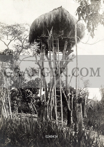 Image of LUZON ISLAND, PHILIPPINES  - Kalinga Tribespeople Sit In