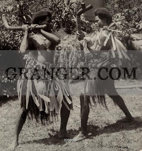 Image of FIJI ISLANDS  - Two Fijian Men Demonstrate A Traditional