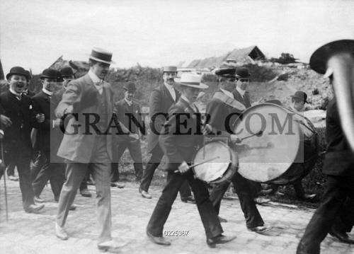 Image of CUSTOM  - Belgium, Ecaussinnes: Unmarried Men Arriving With