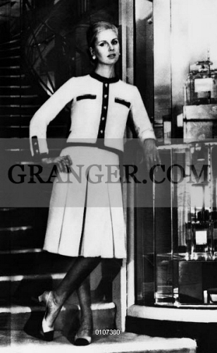6dba0dbb32e Image of CHANEL SUIT. - Woman Modelling A Suit Designed By Coco ...