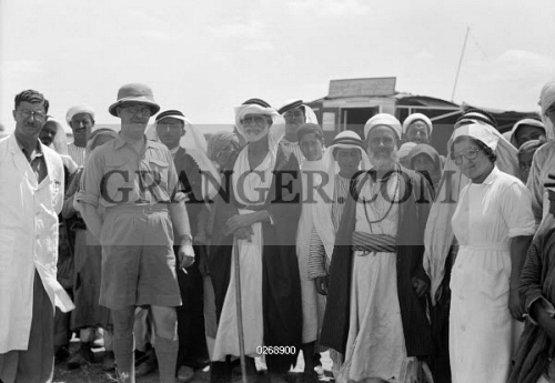 MIDDLE EAST: MOBILE CLINIC. Doctors and nurses of the Palestinian Department of Health Mobile Ophthalmic Clinic with villagers outside of Najd, Gaza. Photograph, August 1939.