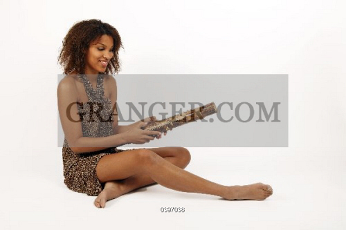 Young African Woman Playing A Valiha Bamboo Zither Or Tube Harp