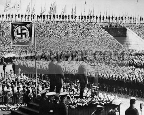 image of nuremberg rally 1938 adolf hitler addressing