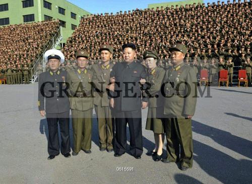 Image of NORTH KOREA  - Kim Jong Un (4th L) Poses For A